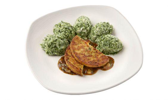 Standaard Spinaziestamppot met een groenteburger met peterseliesaus