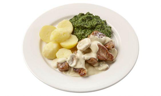 Zoutarm Varkenshaasstukjes in champignonsaus, met spinazie à la crème en gekookte aardappelen