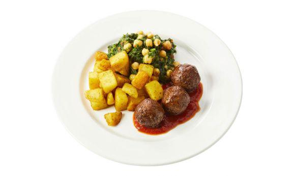 Standaard Spaanse gehaktballetjes in pittige tomatensaus, spinazie met kikkererwten en knoflook-aardappeltjes