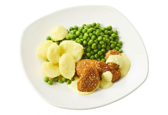 Standaard Vegetarische nuggets met mosterdsaus, doperwtjes en gekookte aardappelen